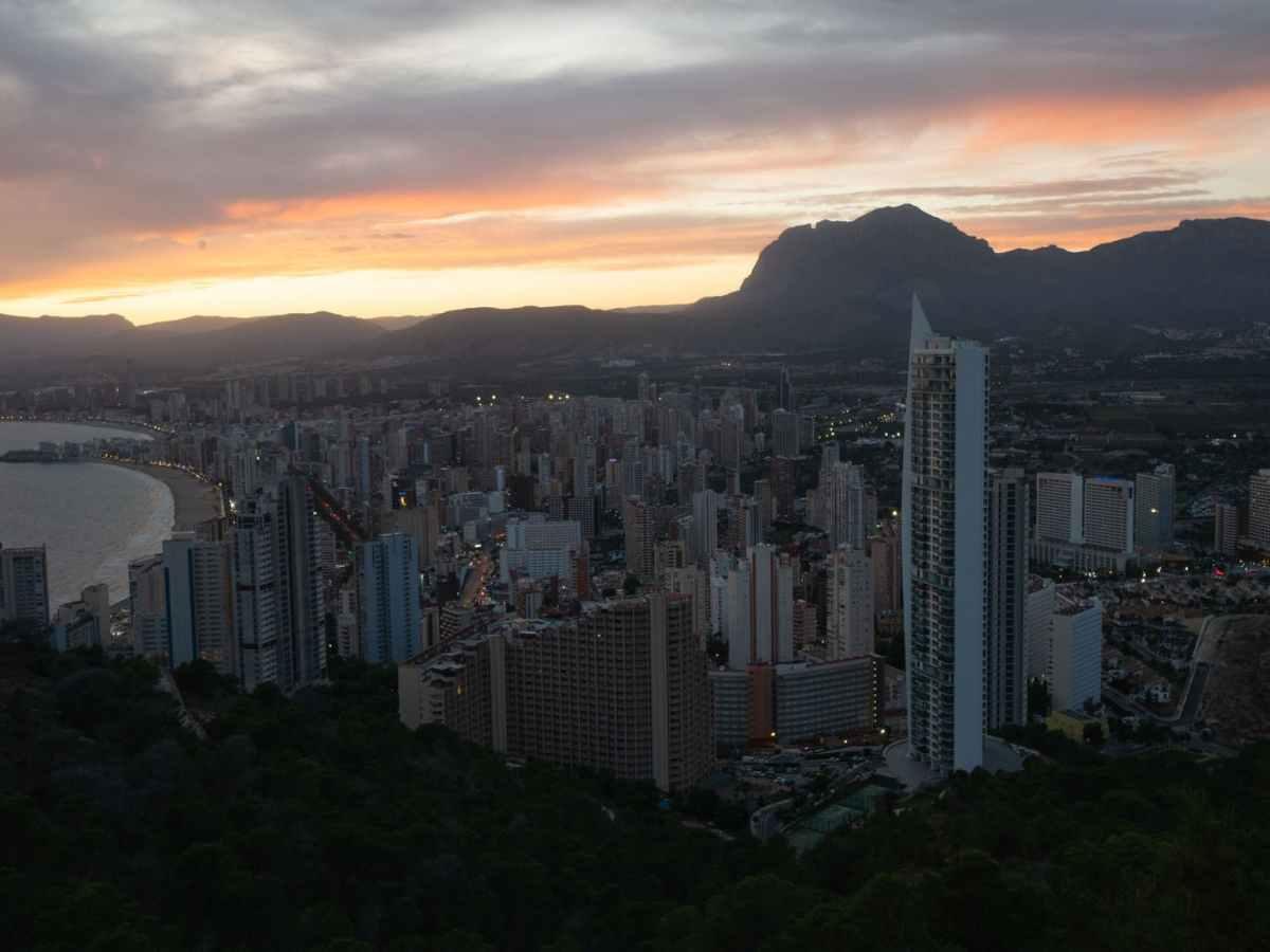 coastal city with modern architecture under sundown sky