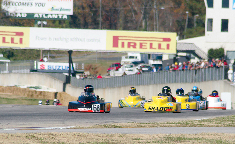 the racerhead dives into turn one at road atlanta during a world karting national event