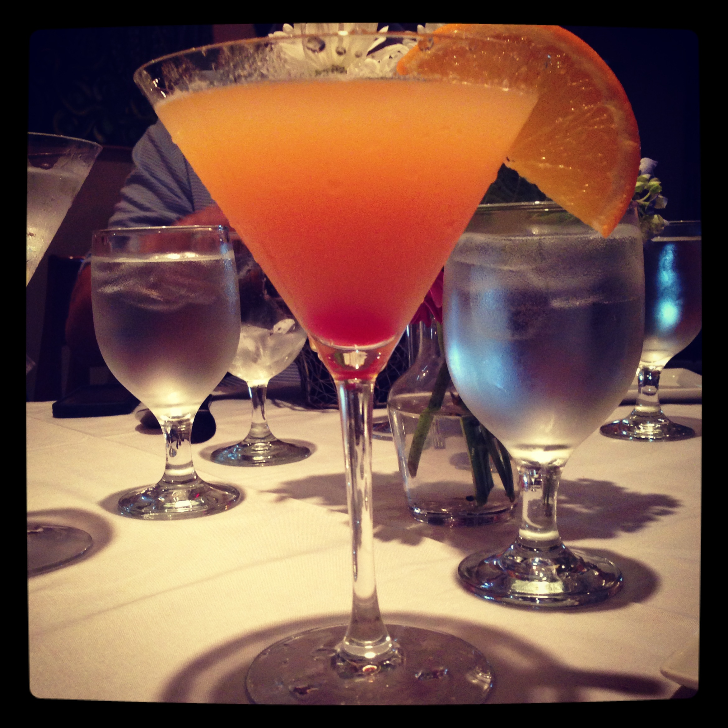 Fresh peach martini with a float of Prosecco!