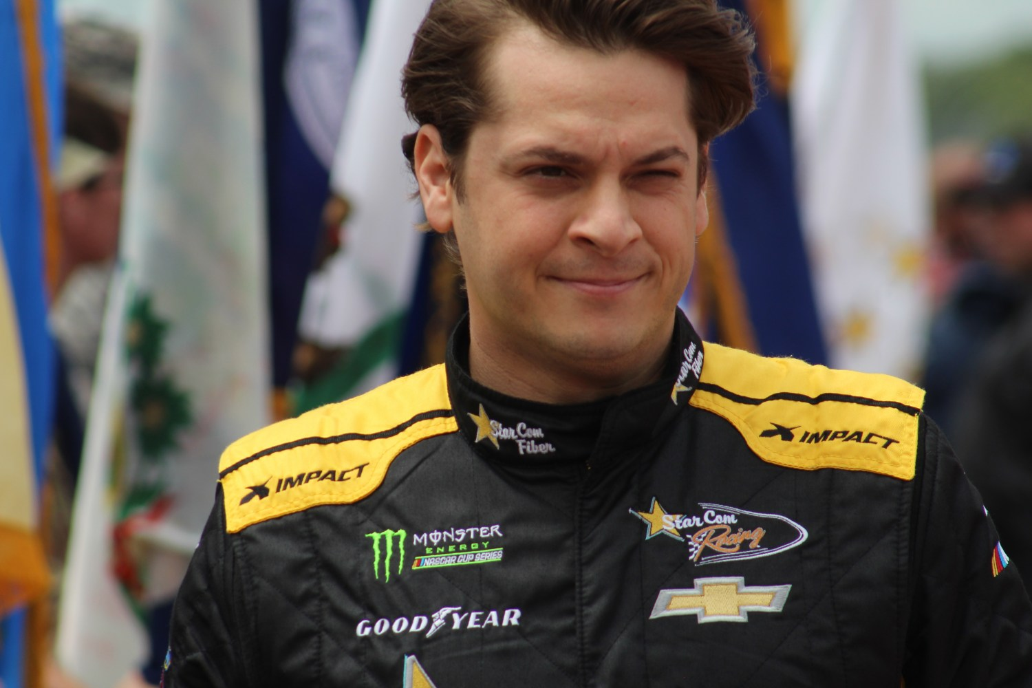 Landon Cassill walks during driver introductions for the 2018 Pocono 400. (Tyler Head | The Racing Experts)