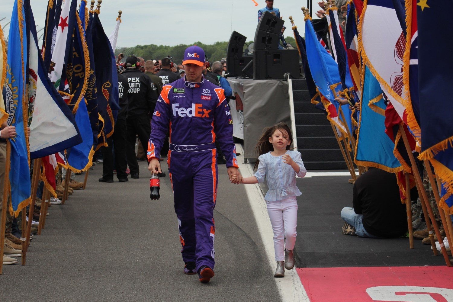 Denny Hamlin walks during driver introductions for the 2018 Pocono 400. (Tyler Head   The Racing Experts)
