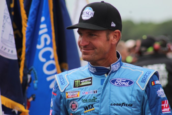 Clint Bowyer walks during driver introductions for the 2018 Pocono 400. (Tyler Head | The Racing Experts)