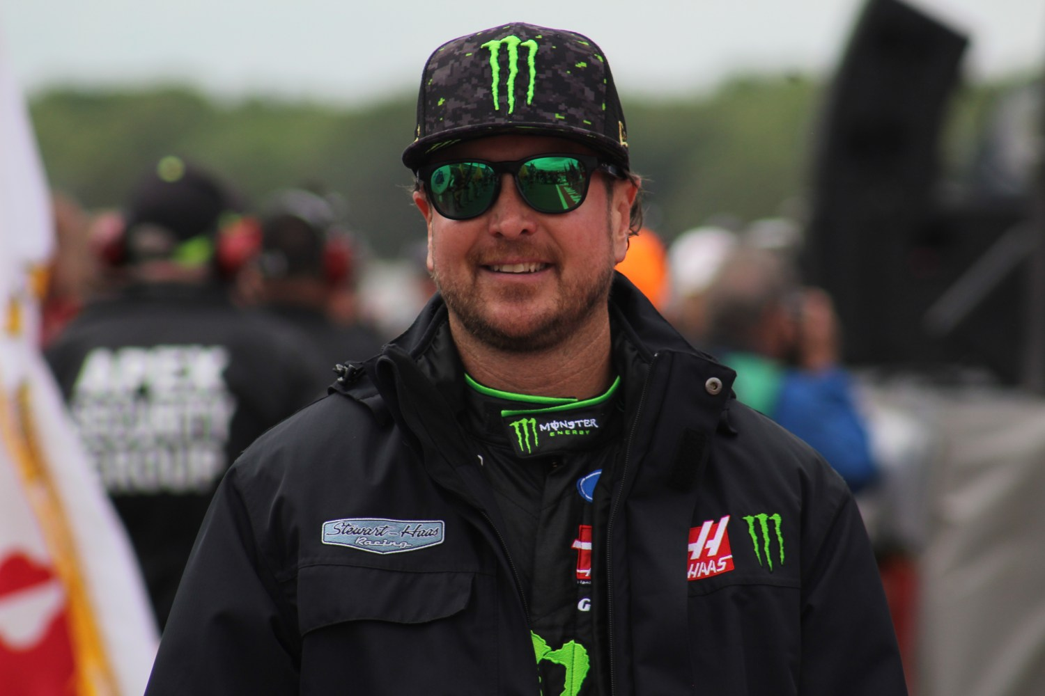 Kurt Busch walks during driver introductions for the 2018 Pocono 400. (Tyler Head   The Racing Experts)