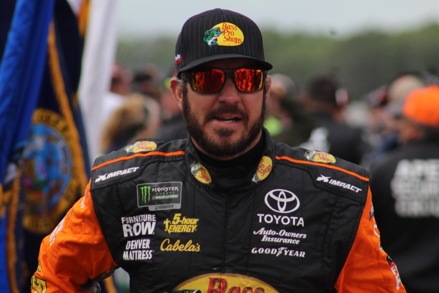 Martin Truex Jr. walks during driver introductions for the 2018 Pocono 400. (Tyler Head | The Racing Experts)