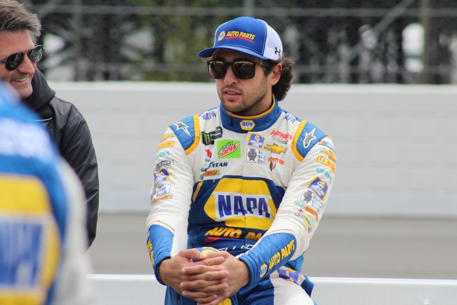 Chase Elliott sits on the pit wall ahead of the 2018 Pocono 400. (Tyler Head | The Racing Experts)