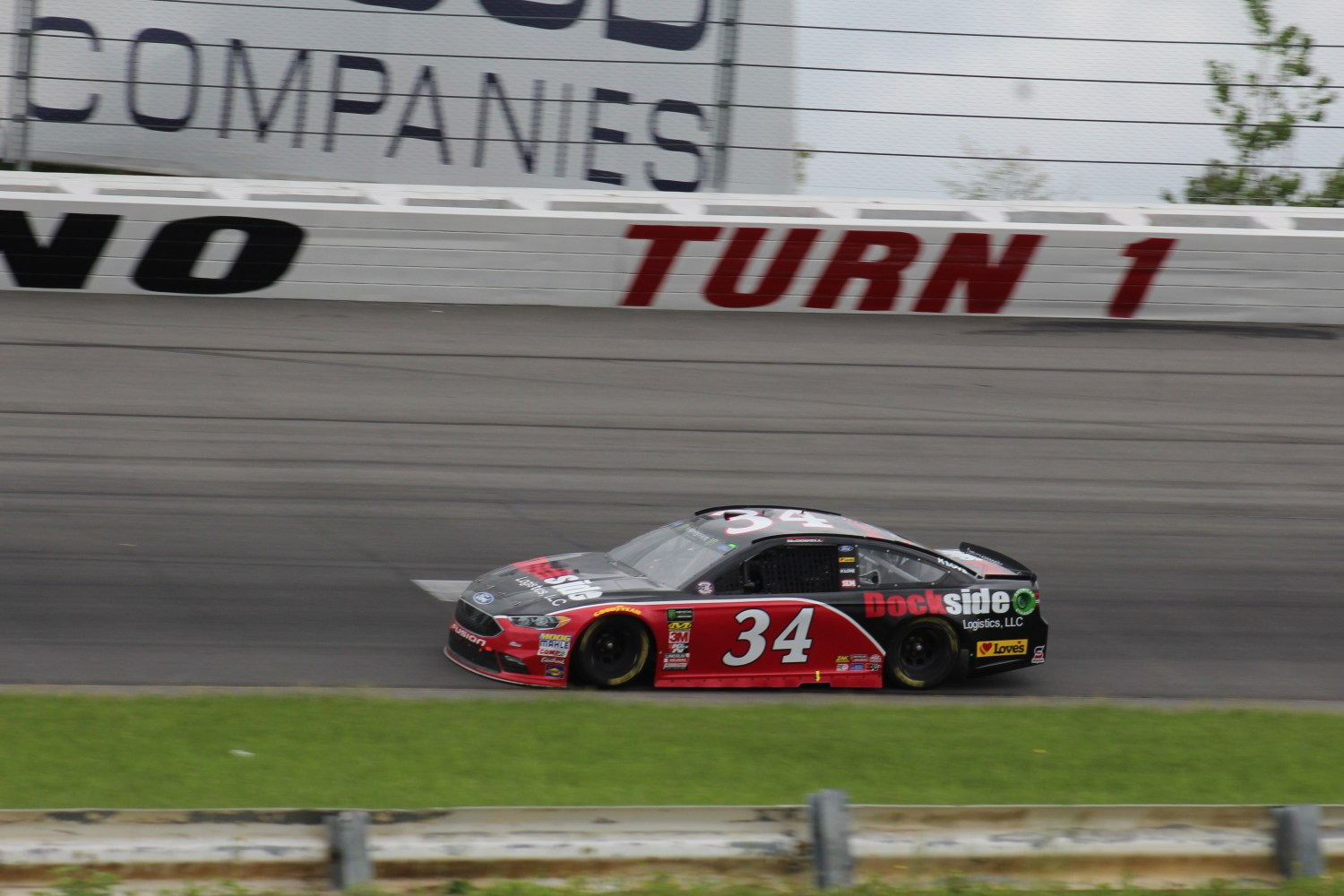 Michael McDowell races during the 2018 Pocono 400. (Tyler Head | The Racing Experts)