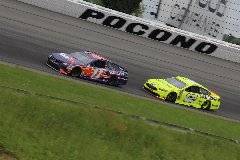 Denny Hamlin (11) and Ryan Blaney (12) race at Pocono