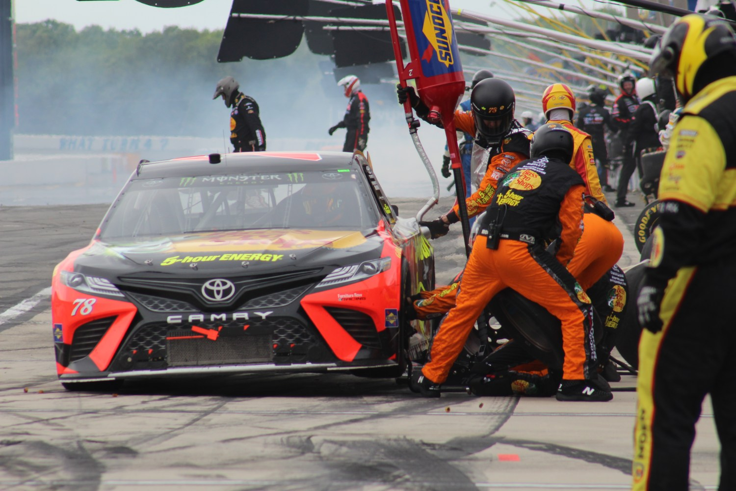 The No. 78 gets service during a pit stop at Pocono.