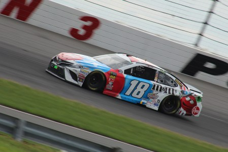 Kyle Busch races through turn 3 at Pocono