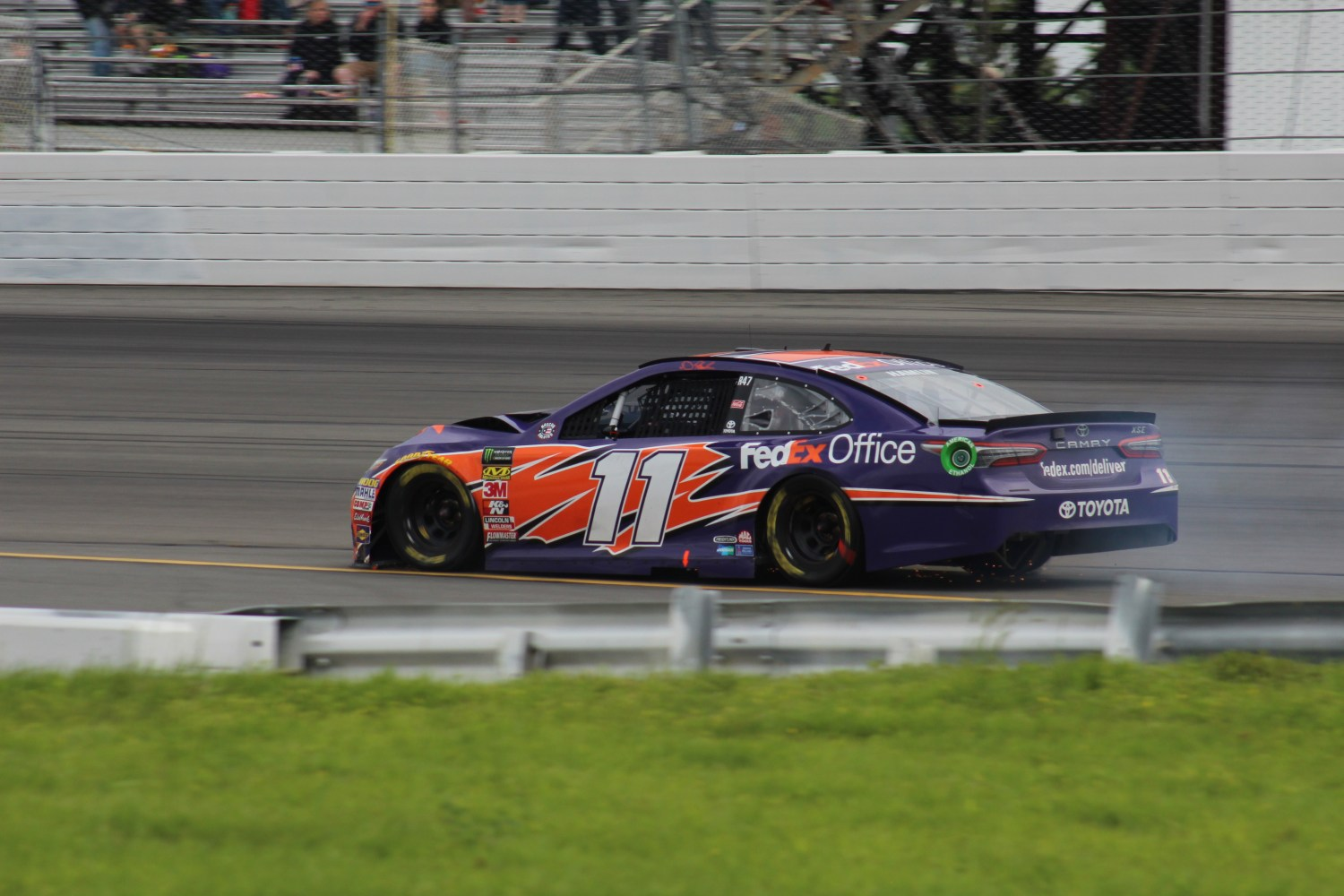 Denny Hamlin drives a damaged No. 11 back to the pits.