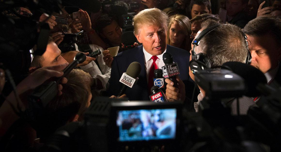 Republican presidential candidate Donald Trump speaks to the media.