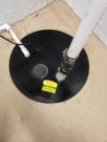 Sump pump lid is carefully replaced and sealed tight. Added view port allows visibility below lid.