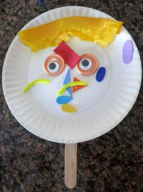 Self-portrait/Mask. Connor did most of this one himself, and is officially excited to go to art class!
