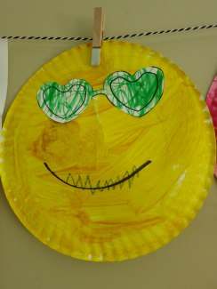 Smiling sun with teeth - mixed media.