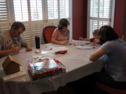 Painting ornaments with Nana, Papa, and Mommy.