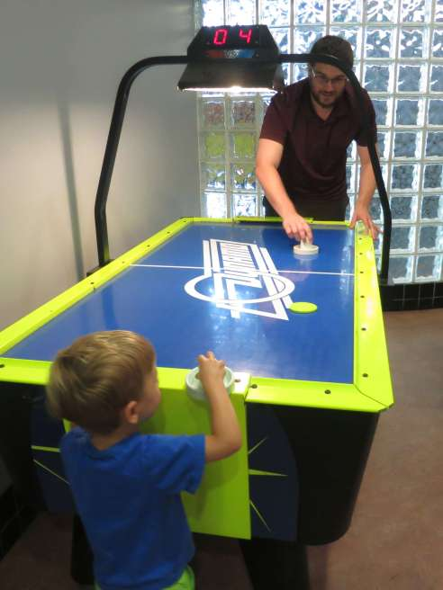 Playing air hockey with Uncle Michael.
