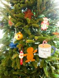 So many ornaments - two gingerbread men, two Santas, a Christmas tree, a snowflake, and a cup of hot chocolate.
