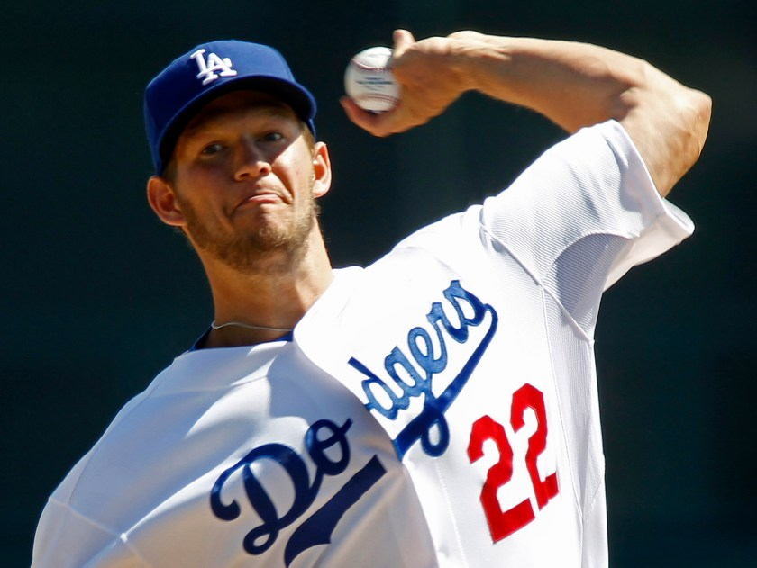 Los Angeles Dodgers starting pitcher Clayton Kershaw delivers a pitch against the Cincinnati Reds during the third inning of their MLB Cactus League spring training baseball game in Glendale, Arizona, March 22, 2013. REUTERS/Ralph D. Freso (UNITED STATES - Tags: SPORT BASEBALL) - RTXXTOO