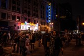 Event-goers stroll down the blocked off street taking in the sights of the festivities.