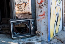 A broken television set sits surrounded by fire rubble at Salton Sea Beach.