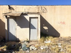 """Part of a destroyed building on the way to Slab City, California boasts graffiti reading, """"USA."""""""