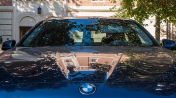 A newer BMW reflects USC's Doheny Library.