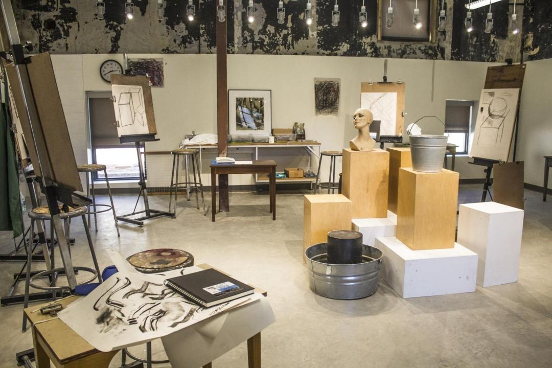 The main room in the Polytechnic Firehouse, now housing the art classes, used to hold the fire department's horses.