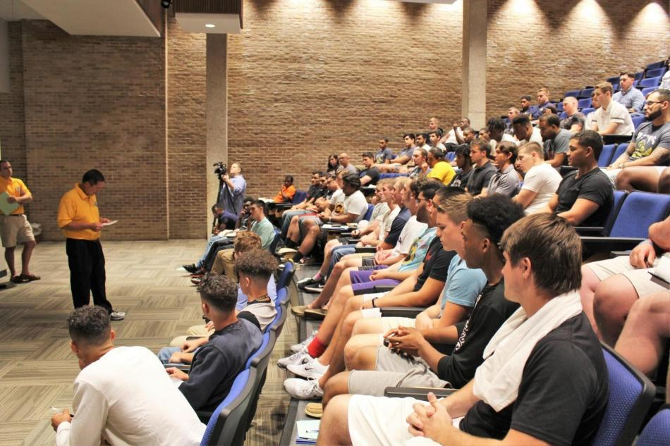 Head football coach Joe Prud'homme addresses players at first team meeting.