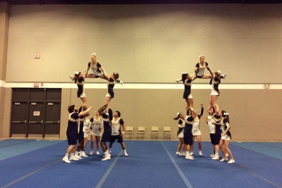 Cheerleaders move beyond the mat