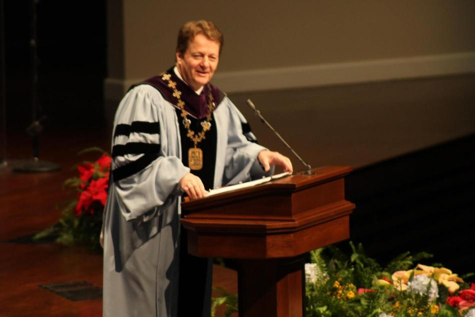 President Frederick Slabach congratulates the graduates at the ceremony at MacGormen Chapel. Photo by Shaydi Paramore