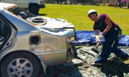 Students relieve stress at car-bashing event