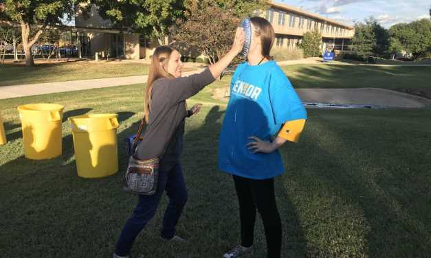 Students throw whipped cream during Block Party