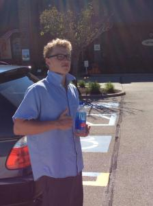 Sophomore Calvin Behm gives Fiji Water his thumbs up symbol of approval.