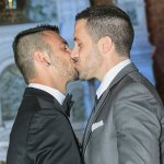 Stock photo of two men kissing after being married