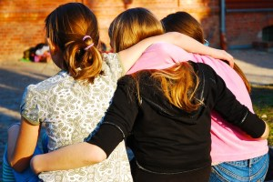 3 females walking away holding eachother | Children, Adolescent & Teen Counseling | Jennifer Levin | Therapy Heals | Pasadena, CA 91106
