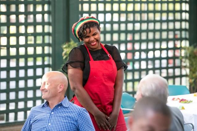 Chantoll Williams of Rasta Mama's Kitchen smiling at a customer.