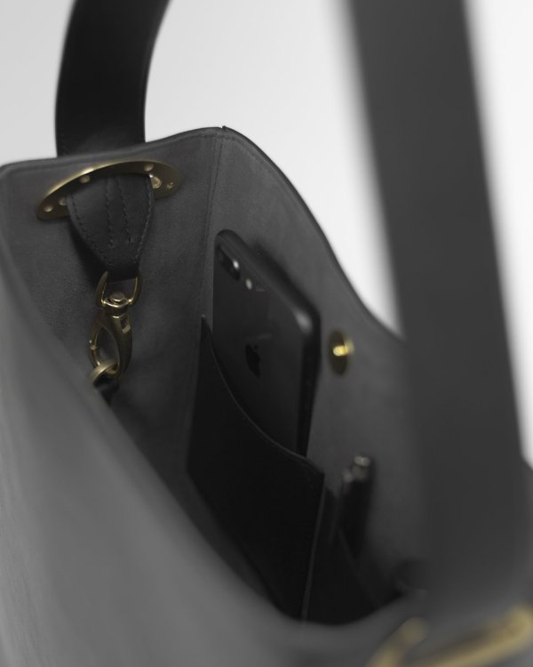 Inside of a black Bucket bag in sustainable vegan leather