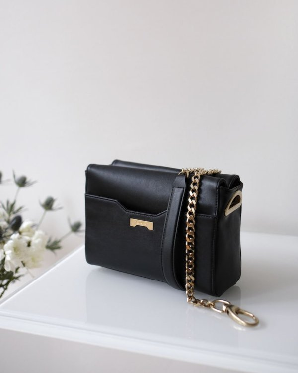 Designer vegan leather in back with gold chain strap