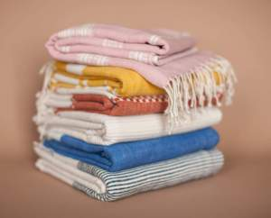 Folded Colourful Cotton Beach Towels handmade quality from Ethiopia