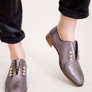 Silver Metallic coloured sustainable flat shoe with golden piercings by ALINASCHUERFELD