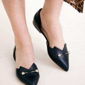 Black coloured sustainable LOULOU Loafer with golden piercings by ALINASCHUERFELD