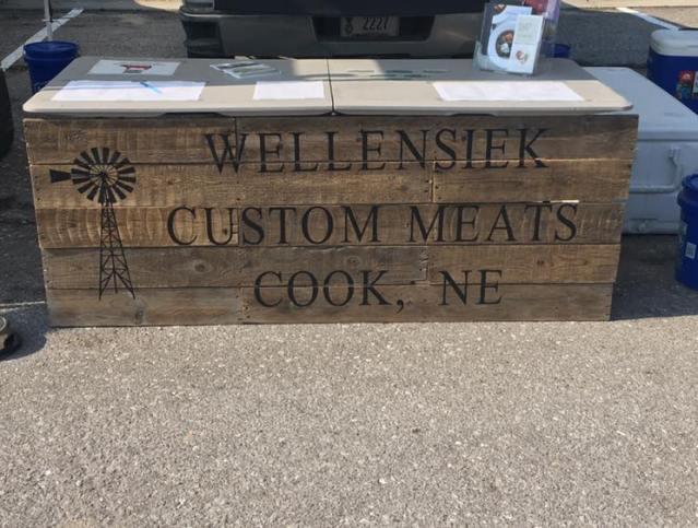 Wellensiek Custom Meats Cook NE display at Farmers Market