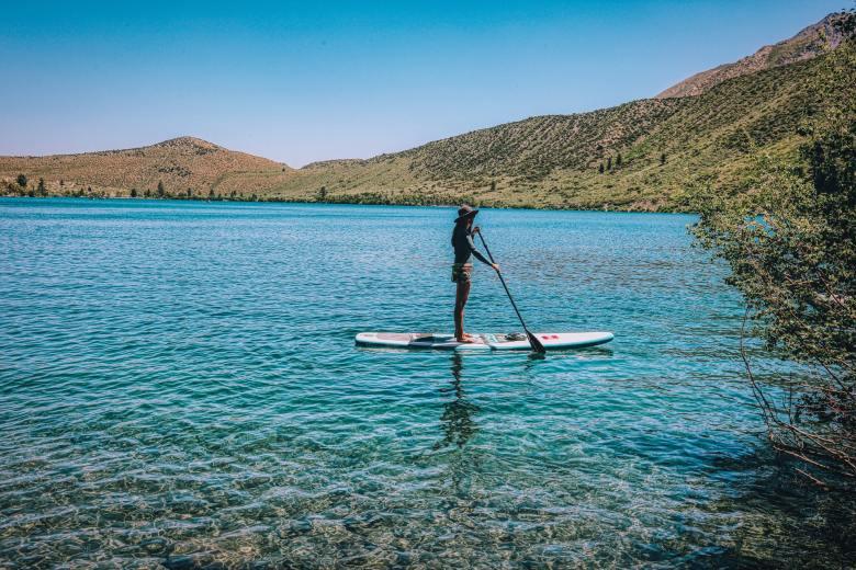 Girl paddle boarding on lack