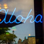 thereafterish feature photo of north shore neon sign saying aloha in Haleiwa