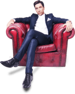 Russell Kane in an armchair