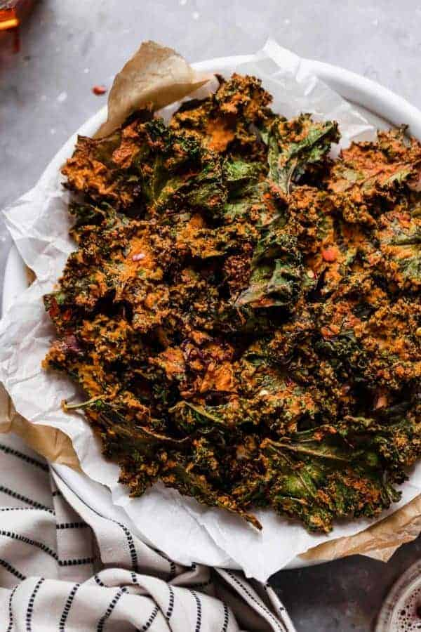 Overhead photo of the Cheese Pizza Kale Chips on a plate.