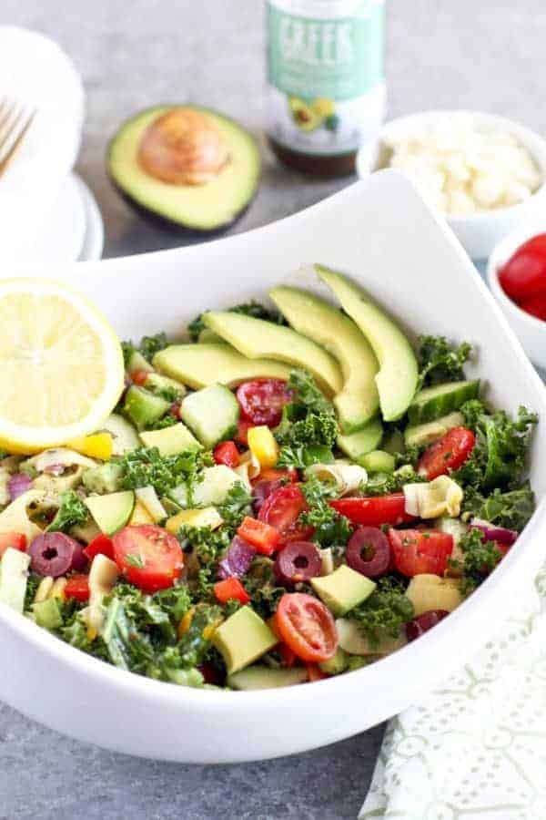 Greek Kale Salad with Avocado | The Real Food Dietitians | https://therealfoodrds.com/greek-kale-salad-avocado/