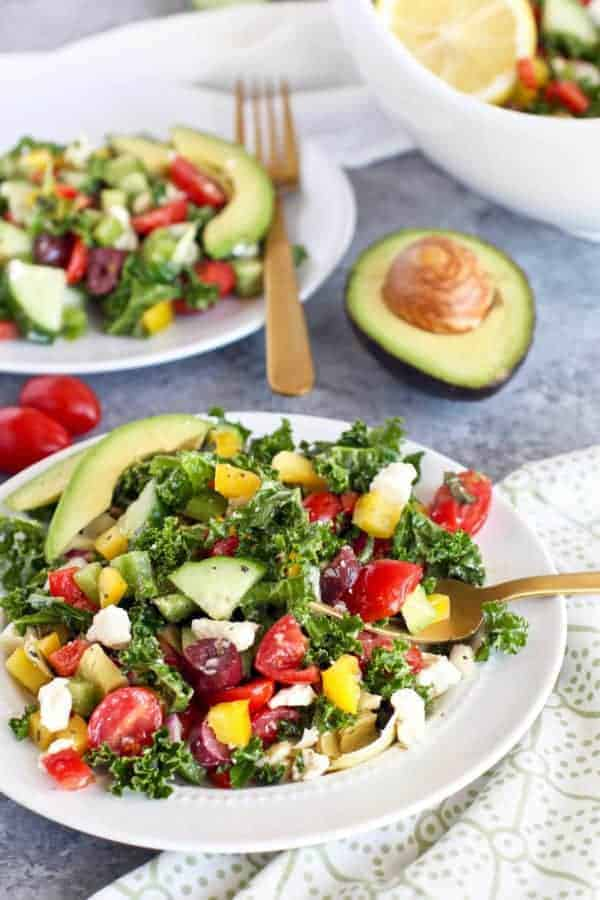 Greek Kale Salad with Avocado   The Real Food Dietitians   https://therealfoodrds.com/greek-kale-salad-avocado/
