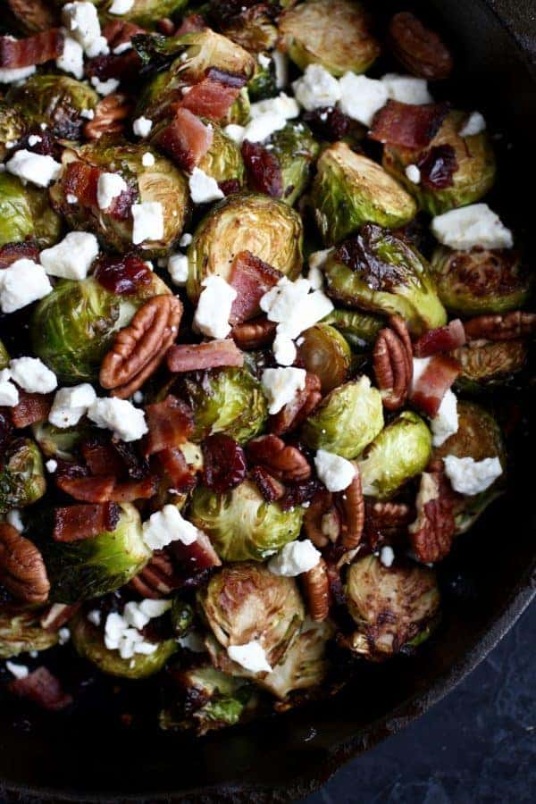 Roasted Brussels with Bacon & Feta   easy Brussels sprouts recipes   healthy Brussels sprouts recipe   gluten-free side dish   grain-free side dish   egg-free side dish   paleo side dish   how to cook Brussels sprouts    The Real Food Dietitians #brusselssprouts #glutenfreesidedish #paleorecipe