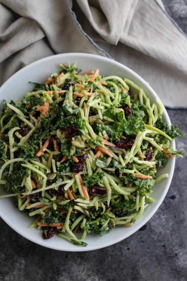 White bowl of broccoli slaw with carrots